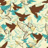 Vector seamless pattern of a flock flying pigeons Royalty Free Stock Photo