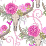 Vector seamless pattern of flowers and skulls c buffalo. Vector background with the image of garden flowers peony, roses, ornamental grasses, berries, ribbons Royalty Free Stock Photo