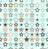 Vector seamless pattern. Geometric seamless pattern. The stars of different sizes and different colors. The pattern elements are arranged on light green Royalty Free Stock Photos