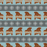 Vector seamless pattern with gingerbread sheep and snowflakes. Royalty Free Stock Images
