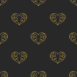 Vector seamless pattern with golden hearts on dark background. Stock Photos