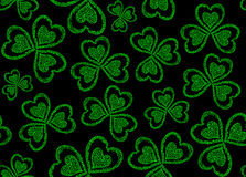 Vector seamless pattern with green figured clover leaves for St. Patrick's day Stock Photography