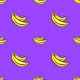 Vector seamless pattern with hand drawn bananas on a purple background. Royalty Free Stock Image