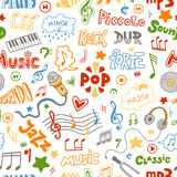 Vector seamless pattern of hand drawn doodles on a music theme. Stock Photos