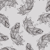 Vector seamless pattern with hand-drawn feathers Royalty Free Stock Images