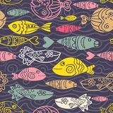 Vector seamless pattern with hand drawn funny fishes and waves in sketch style. Decorative endless marine dark background. Fabric. Vector seamless pattern with Stock Image