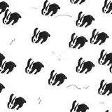Vector seamless pattern with hand drawn rabbits. Ink splatter tiling texture with bunnies. Brush splatter, black pen art in infantile childish style. Beautiful stock illustration