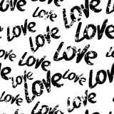 Vector seamless pattern with hand drawn word love,  on w Royalty Free Stock Photo
