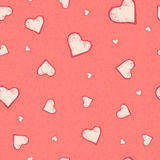 The vector seamless pattern of the heart on pastel pink grunge background. Stock Images