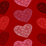 Vector seamless pattern of hearts on a blood-red background Stock Photography