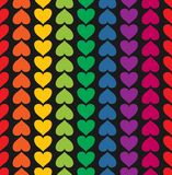 Vector seamless pattern with hearts colored like. Vector seamless pattern with valentine hearts on black Royalty Free Stock Images