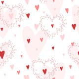 Vector seamless pattern with hearts different shades of red and hand drawn wreathes. Stock Images