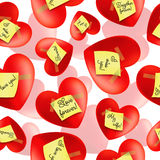 Vector seamless pattern of hearts with inscription Stock Images