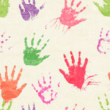 Vector seamless pattern with human palm prints Royalty Free Stock Photos