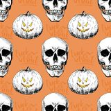 Vector seamless pattern of human skulls and pumkins Hand drawn engraved style. Happy Haloween. Vector seamless pattern of human skulls and pumkins  on orange Royalty Free Stock Photography