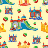 Vector seamless pattern of inflatable castles and children hills Royalty Free Stock Images