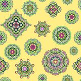 Vector seamless pattern from mandalas on yellow background. Abstract background Royalty Free Stock Image