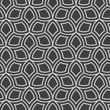 Vector seamless pattern. Monochrome graphic design. Decorative geometric leaves. Regular floral background with elegant petals.  Stock Images