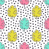 Vector seamless pattern with monstera palm leaves and polka dot background. Trendy summer tropical design vector illustration