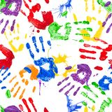 Vector seamless pattern with paint handprints Royalty Free Stock Photos