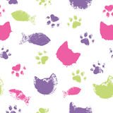 Vector seamless pattern with paw footprints, cat muzzles and fish Stock Photos