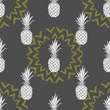 Vector seamless pattern with pineapple. Background in yellow and grey colors. Royalty Free Stock Images