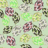 Vector seamless pattern of psychedelic shapes in the form of leaves. Royalty Free Stock Image