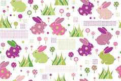 Vector seamless pattern, rabbits in flowers. Stock Photo
