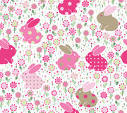 Vector seamless pattern, rabbits in flowers. Royalty Free Stock Images