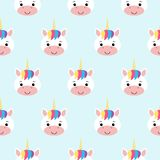 Vector seamless pattern with rainbow unicorns. Blue background royalty free illustration