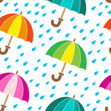Vector seamless pattern. Rainy day and bright umbrellas Stock Photos