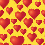 Vector seamless pattern with red hearts on the yellow background. Stock Photography