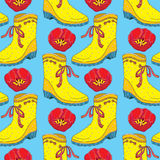 Vector seamless pattern with red tulips flower and yellow rubber boot with bow on the blue background. Floral background. Stock Image
