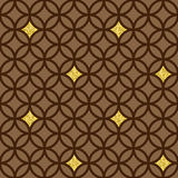 Vector seamless pattern with rings and golden glitter. Seamless geometric pattern with circles / rings and golden glitter. Geometric background in brown colors Royalty Free Stock Image