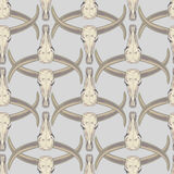 Vector seamless pattern with sculls of the buffalo. Vector background with the image of buffalo skulls. Seamless pattern Stock Photography