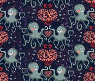 Vector seamless pattern of sea life, cute octopuses and corals on the dark blue background stock images