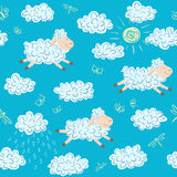 Vector seamless pattern with sheep and clouds. On a blue background Royalty Free Stock Image
