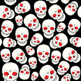 Vector seamless pattern with skulls. Stock Photo