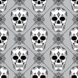 Vector seamless pattern with skulls. Stock Photos