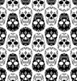 Vector seamless pattern with skulls. Royalty Free Stock Photo
