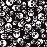 Vector seamless pattern with skulls and bones Royalty Free Stock Photography