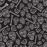 Vector seamless pattern with skulls, bones and hearts on black b Royalty Free Stock Images