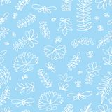 Vector seamless pattern with small stylized flowers on a blue background. Hand drawing Royalty Free Stock Images