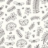 Vector seamless pattern with small stylized flowers and branches. Hand drawing. Royalty Free Stock Images
