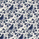 Vector seamless pattern with songbird and flowers. Seamless backdrop in vinage style. Blue birds on light background Stock Photo