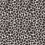 Vector seamless pattern of stylized leaves and petals Stock Photography