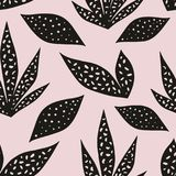 Vector seamless pattern with stylized leaves on a pink background. Hand drawing Royalty Free Stock Photo