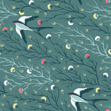 Vector seamless pattern with swallow birds and floral background Royalty Free Stock Image