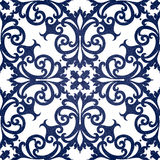 Vector seamless pattern with swirls and floral motifs in retro style. Royalty Free Stock Photos