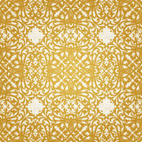 Vector seamless pattern with swirls and floral motifs in retro style. Golden Victorian background. It can be used for wallpaper, pattern fills, web page Stock Photography
